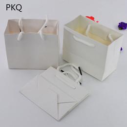 tiendas de zapatos de boda Rebajas 10 unids 34 * 8 * 28 cm Bolsas de papel grandes Bolsa de compras con la manija de la ropa paquete de bolsas de regalo del banquete de boda bolsas de embalaje de papel de regalo
