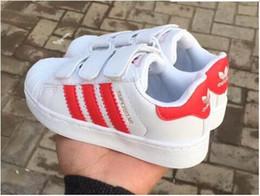 Niños corriendo zapatillas chicas online-2018 nueva marca Shell Head boy chicas Sneakers Superstar niños Kids Shoes new stan shoes moda smith sneakers cuero deporte zapatillas
