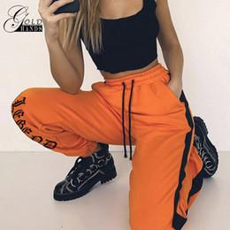 Женщины Loose Sweatpants Harajuku Брюки Осень Женские Оранжевые Письмо Печатные штаны Joggers Брюки Hip Hop Dance Pants Plus Размер