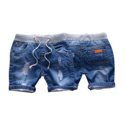 b3fe511df9718 Bébé Garçon Fille Trou Jeans Shorts Été Enfant Enfants Vêtements Enfants  Pantalon Court Vetement Enfant Garcon Fille Ete Spodenki