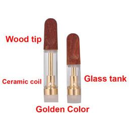 serbatoio dell'olio di hash Sconti Ecigs Wood Tip TH205 Golden Vape Cartridges Serbatoio vuoto in vetro Serbatoio monouso Vaporizzatore Bobine ceramiche 510 Thread Co2 Hash Oil Atomizer
