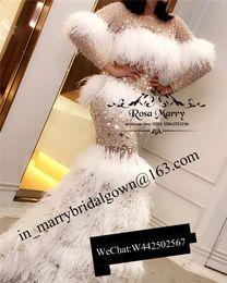 champagner-dünnes abschlussballkleid Rabatt Luxus-Kristall-Feder-Nixe-Abend-Kleider 2019 plus Größe langen Ärmeln Illusion Rock Dubai Arabisch Formal Promi Pageant Abendkleider