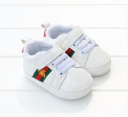 Wholesale buckle brand shoes - 2018 hot New Romirus toddler moccasins baby shoes PU Leather first walker shoes soft sole Newborn girls boys Brand sneakers 0-18M