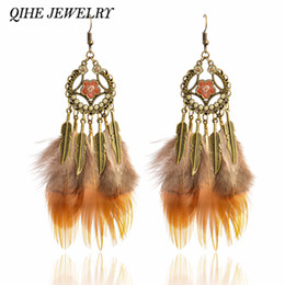 Wholesale Gypsy Style Jewelry - QIHE JEWELRY Feather earrings Bronze flower charm brown natural color feather earrings Feather jewelry Gypsy style oorbellen