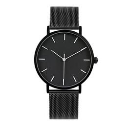 2019 модные черные часы 2017 Enmex прохладный стиль мужчины наручные часы краткое vogue простой стильный черный и белый лицо из нержавеющей стали кварцевые часы мода часы дешево модные черные часы