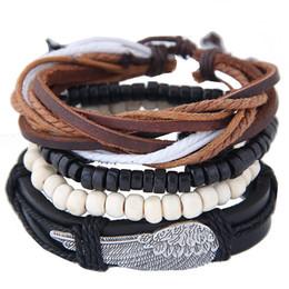 Retro accesorios de la joyería de la vendimia de la armadura de plumas de cuero alas de la declaración del encanto del encanto de los brazaletes de las pulseras de múltiples capas pulseras para las mujeres desde fabricantes