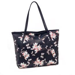 Impresión floral de los bolsos negros online-De cuero con cremallera ocasional bolsa de compras de verano grande Tote bolsos de las mujeres impresos damas bolsos de hombro femenino bolso de playa negro