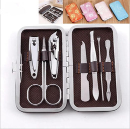 cucharear las uñas Rebajas Alta calidad tijeras cortaúñas kit de belleza podadoras de clavo del oído cuchara ceja de 7 pedazos de tapa dura