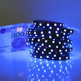 Tira de luz led púrpura 12v online-Impermeable / No impermeable 5M UV Uv tira de LED 395nm 5050 SMD Púrpura 300 LED Flex Strip Light 12V