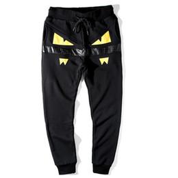 Wholesale Harem Pants Free Shipping - Causal yellow devil eyes harem pants for men tide brand monster pencil pants men fashion cotton men pants S-7XL free shipping