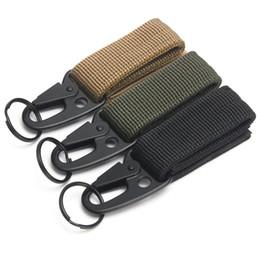 1 unids acampar al aire libre mosquetón táctico mochila ganchos Olecranon Molle Hook Survival Gear EDC Nylon militar llavero cierre desde fabricantes