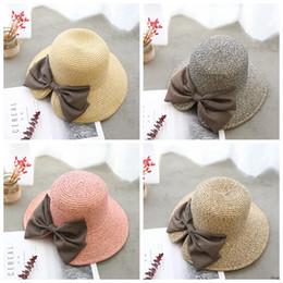элегантные шляпы для пляжа Скидка Бантом ведро шляпа складной пляж шляпы хлопок белье элегантный мода девушки женщины широкими полями шляпы для отдыха путешествия шляпа 4 цвета Оптовая