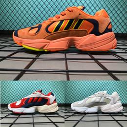 Argentina 2018 zapatos corrientes de alta calidad 700 Wave Runner versión corta zapatos deportivos viejos 700 hombres mujeres zapatillas de deporte tamaño Eur 36-45 supplier runner shorts men Suministro
