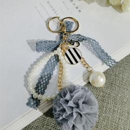 perlen metall ball kette Rabatt Neue Mode Schlüsselanhänger Stoffe Und Spitze Blume Schlüsselanhänger Perlen Und Perle Schlüsselanhänger Frauen Tasche Zubehör Hohe Qualität Kein Rost Metall Schlüsselanhänger