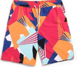 Argentina 2017 2017 hombres y mujeres pareja pantalones de playa de secado rápido de gran tamaño sueltos pantalones casuales impresos color a juego pantalones de flores cinco pantalones Suministro