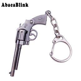 Argentina 15 estilos lindo juguete pistolas llavero modelo de metal Revolver Desert Eagle coche llavero moda hombres llaveros con caja de regalo cheap revolver keychain Suministro