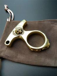 Череп латунь брелок EDC палец кольцо кастеты сломанные окна портативный KeyPendant Emergencyset cheap edc ring от Поставщики кольцевое кольцо