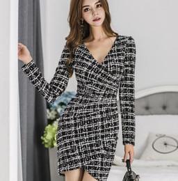 e24db4097 018 otoño versión coreana de la nueva moda de las señoras sexy delgado  profundo con cuello en V vestido de impresión bolsos cadera vestido