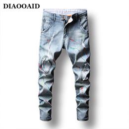 2ec41311a72c DIAOOAID 2018 Neue Marke design stil mode hosen farbe tinte blue jeans  männer streetwear hiphop persönlichkeit männlichen denim hosen malerei blue  jeans ...