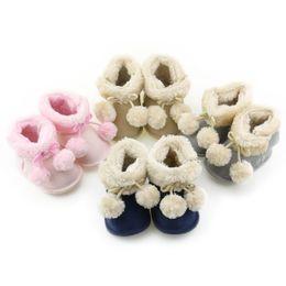Wholesale Pink Newborn Booties - Newborn Infant Baby Boys Girls Boots Crib Bebe Footwear Winter Warm Ball Lace Cute Booties Soft Sole Snowfield Prewalkers Shoe
