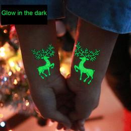 crianças parede luz lâmpada atacado Desconto Brilham nas decorações do tatuagem do boneco de neve escuro do Natal Rena do floco de neve descartável tatuagens festa de Natal Drop Ship 110213