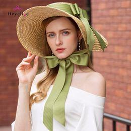 0930355ba4c Fashion Big Brim Summer Straw Hats With Bowknot Vintage Holiday Beach Women  Hats Sun Caps High Quality Lady