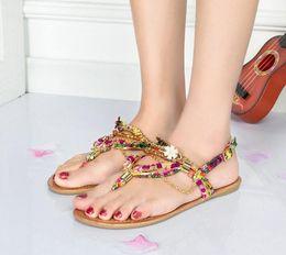 Sandalias planas de oro con cuentas online-Sandalias de cuentas bohemias hechas a mano de la cadena de oro Flores de metal Sandalias planas de diamantes de imitación sandalias dulces coloridos Zapatos de gladiador romano