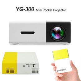 Filmes laptop on-line-Mini Projetor YG300 Portátil LEVOU Projetor Home Movie Cinema Teatro LCD com Laptop PC Smartphone Suporte USB SD AV HDMI Bolso Beamer