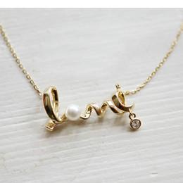 Canada Bijoux coréens européens et américains en gros mode sens de l'attraction pendentif court anglais amour simplifié alphabet diamant pendentif Offre