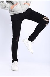 Wholesale Loose Fitting Pants - Ripped Mens Black Jeans Slim Fit Knees Holes Pencil Pants Kanye West High Street Skinny Long Trousers Clothing