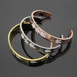 Wholesale Channel Wheels - Titanium steel jewelry wholesale C-shaped bracelet open gear wheel white drip pattern G letter bracelet ladies bracelet