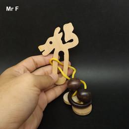 Dragones de madera chinos online-Regalo de madera Puzzle Dragon Shape Loop Puzzle Chinese Mind Game modelo de enseñanza Brainteaser juguetes para niños