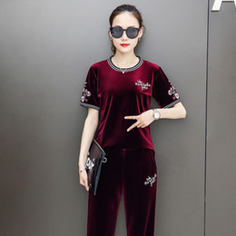 c35efadf8dea Le donne di stile cinese si adatta di buona qualità Pantaloni a maniche  lunghe in velluto a maniche corte Pantaloni a due pezzi Set da donna  Pullover in ...
