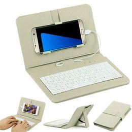Teclado flip on-line-Mini Teclado Com Fio Teclado Sem Fio Bluetooth Flip Coldre Case Para 4.2 Polegada Para 6.8 Polegada Tablet Telefone Móvel