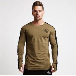 Maglietta a maniche lunghe online-Nuova primavera estate nuovi uomini a maniche lunghe t-shirt in cotone raglan manica palestre abbigliamento allenamento fitness maschile moda casual marca tees top