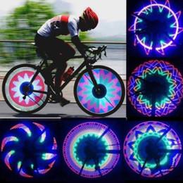 2019 32 luci di segnalazione a led All'ingrosso Raffreddare 2 lato 32 LED 32 modalità notte impermeabile ruota segnale lampada riflettente Rim arcobaleno pneumatico bici bicicletta a raggio fisso avvito luce 32 luci di segnalazione a led economici