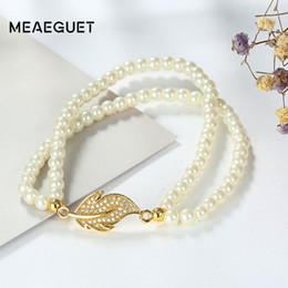 Wholesale food gold leaf - Meaeguet Classic Flexible Simulated-Pearl Paved CZ Leaf Charm Bracelet For Women Double Chain Layered Wedding Band