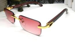 Mejor marca pc online-2018 Mens gafas de sol de lujo sin montura gafas de cuerno de búfalo con lente roja Mujeres gafas de sol para diseñador de marca la mejor calidad con caja