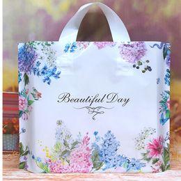 Tienda hermosa online-50 unids / lote 'Beautiful Day' Floral Espesar Plástico Bolsa de transporte de la boda Bolsa de regalo Bolsa de ropa Bolsa de compras