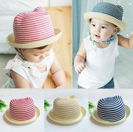 Sombrero de paja para bebé niño online-Gorra para niños sombrero para el sol visera bebé niña niño dibujos animados orejas de gato tapa de paja para niños playa de verano cubo sombrero bebé niños sombreros de sol gorra