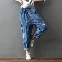 Argentina ASYMSAY 2017 Otoño Nueva Llegada Agujeros Patrón de Cintura Elástica de Las Mujeres Denim Harem Pantalones Estilo Casual Entrepierna Entrepierna Pantalones AC5418 cheap drop crotch trousers women Suministro