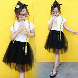 Maglietta bianca del nero del pannello esterno online-Abbigliamento per bambini 2018 Summer New Korean Girl White T-Shirt + Black Gauze Skirt Set di due pezzi