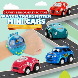Wholesale mini rc remote - 4CH Gravity Sensor Smart Watch Remote Car Control RC mini Racing Toy Car NEW Gift RC Toys For children 12PCS 4colors