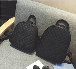 2018 venta caliente clásica famosa moda diamante enrejado bolso negro bolsa de viaje estilo vintage retro mochila desde fabricantes