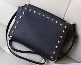 6ec80a9e92 Free shipping 2016 star models with cross pattern PU leather handbags and  small rivet smiley bat bag shoulder bag Messenger bag