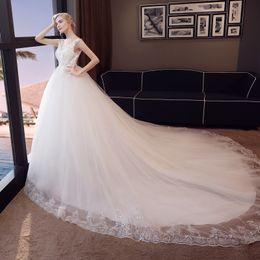 Canada HM2043 Robes de mariée sexy avec appliques de dentelle Robe mariage dos nu balayage train / longueur au sol Robes de mariée robes de mariée Offre