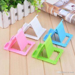 Wholesale Fold File - Universal plastic creative portable tablet flat desktop support folding base 5 file adjustment angle lazy bracket