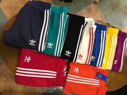 Wholesale track bottom men - 2018 Brand Men women 9 colors Joggers Casual Harem Sweatpants Sport Pants Men Gym Bottoms Track Training Jogging Trousers
