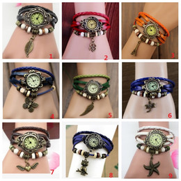 Wholesale Retro Watch Bands - Women Leather Band WristWatches charm Bracelet Retro Watches Vintage Eiffel Tower Pendant Watch Weave Wrap Quartz Watches for Lady