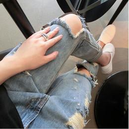 pantalones rotos rodillas Rebajas 2017 Venta Caliente Nueva Moda Mujeres Casual Azul Cintura Media Pantalones Vaqueros Rasgados Agujero Rodilla Flaco Pantalones Lápiz Denim Ripped Jeans MZ568